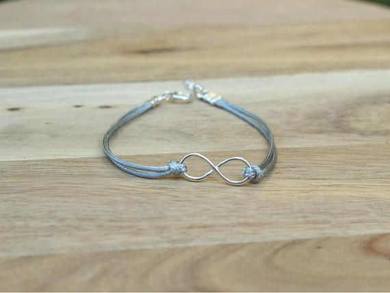 A beautiful stackable gray cotton bracelet with an infinity charm for a man or a woman. This bracelet is made from a black cotton cord and has a sterling silver infinity charm as a centerpiece. This bracelet is a perfect everyday item - it is light and comfortable to wear and it will go with