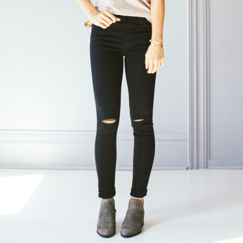 Black jeans with holes in the knees
