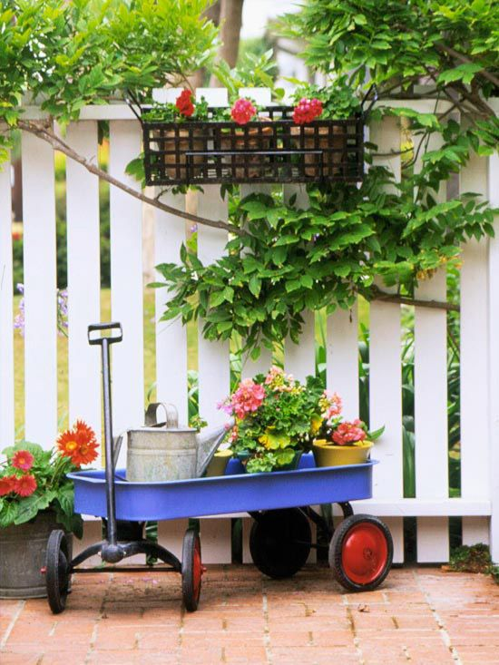 An old wagon ads a classic, rustic element to your patio. More creative ideas: http://www.bhg.com/home-improvement/patio/designs/patio-ideas/?socsrc=bhg050612patiowagonBackyards Ideas Flower, Blue Wagon, Gardens Tools, Flower Baskets, Old Wagon, Summer Colors, Front Porches, Bright Colors, Charms Accent