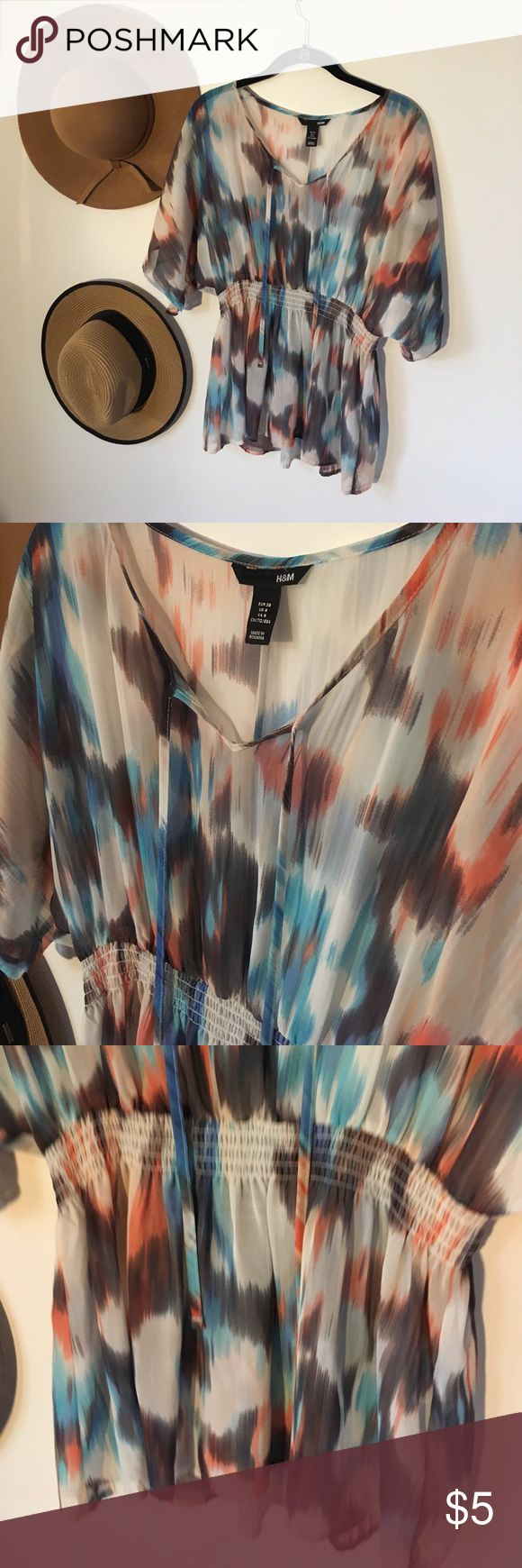 H&M whimsical top. Waist-defining silk top. Perfect for an artsy whimsical look. Looks stylish with a turtle neck underneath for fall/winter and a jean skirt for summer. H&M Tops Blouses