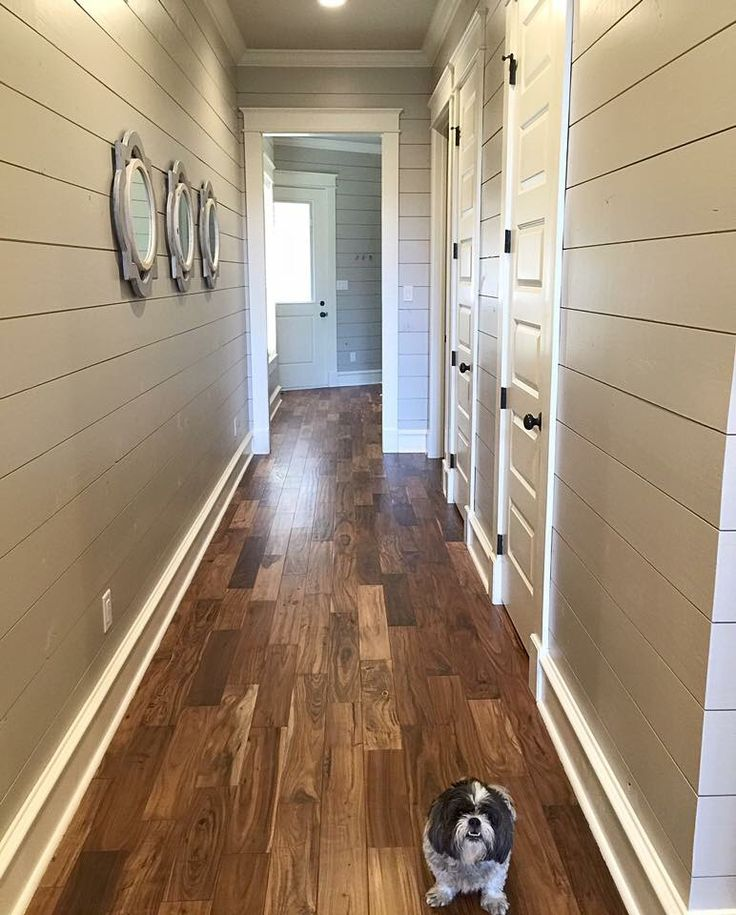 Floors are acacia real wood and paint on ship lap is Benjamin Moore revere pewter with white dove trim.