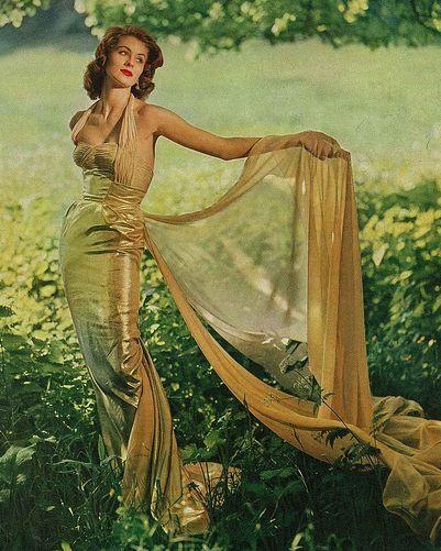 ~Suzy Parker, Vogue 1956~vintage fashion style 50s column sheath long evening gown dress halter gold lame lurex train color photo print ad model magazine grass