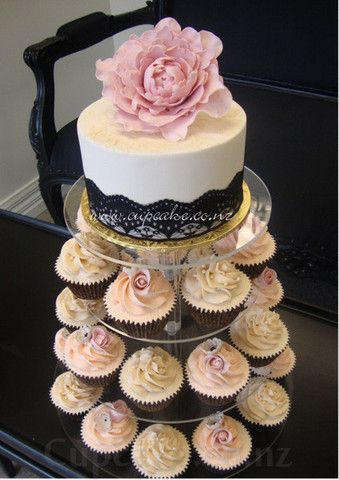 Formal white wedding cake with cupcake tiers