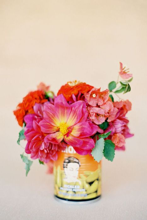 Fuss-free centerpieces, vibrant tin cans with bright blooms create a fiesta atmosphere. Source: style me pretty  #centerpieces #spanishtheme