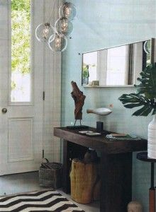 small entry hall - I like the use of attractive baskets for simple storage