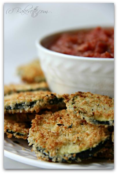 These baked zucchini Parmesan crisps are a delicious easy recipe dipped in an egg, garlic and Italian dressing and coated in a blend of Panko bread crumbs, Parmesan, and Italian spices.