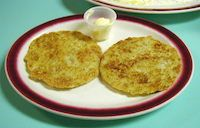 """Johnny Cakes Thick or thin, they'll make you grin! Johnny cakes from Station House Restaurant, West Kingston. A Jonnycake (or Johnnycake) is a fried pancake-like flat bread made from ground corn. Although variants are found all along the east coast of North America, """"from Newfoundland to Jamaica,"""" Rhode Island considers Johnnycake its own."""