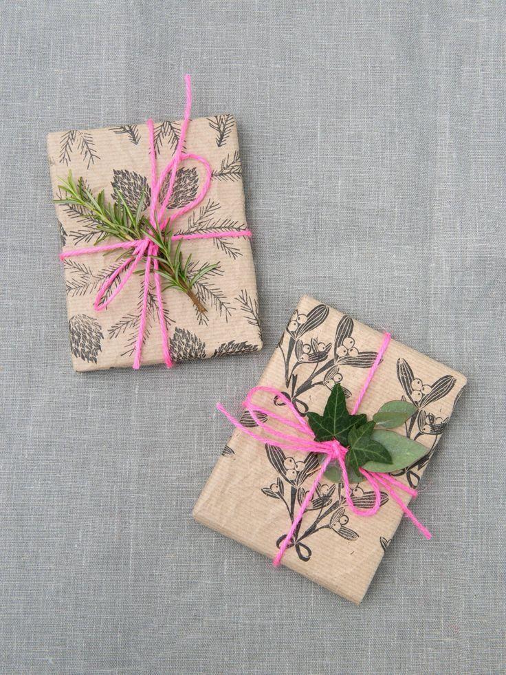 Mistletoe stamped brown paper.