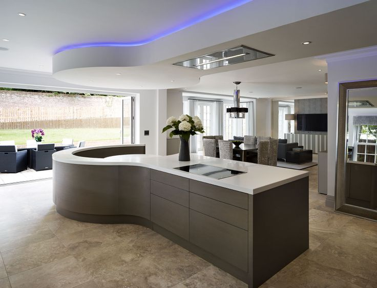 An impressive contemporary bespoke kitchen design from Esher Surrey with wow factor in the design. #surrey #bespoke #kitchendesign #interiordesign #dreamkitchen #bulkhead #banquetseating #openplan