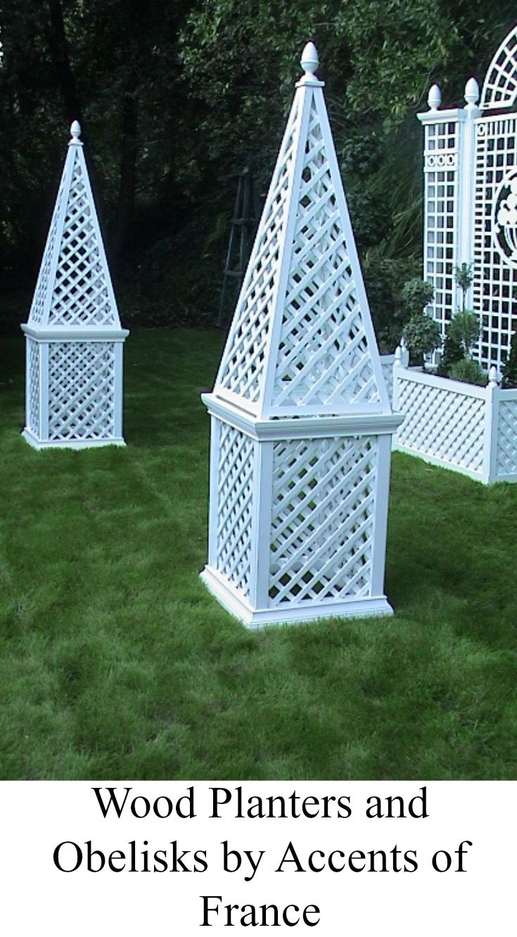 Garden Decoration With White Plant Stands And Wood Obelisks On Top By Accents Of France