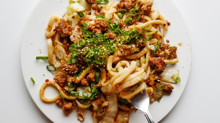 The secret to a flavorful pan-fried noodle? Pork, mirin, and soy sauce.