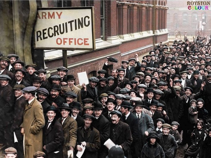 A crowd of young men queuing at the Army Recruiting Office at Walworth Town Hall, Wansey Street, Walworth, Southwark in south London, England during Lord Derby's recruitment campaign. December 1915. Colourised by Royston Leonard from the UK)