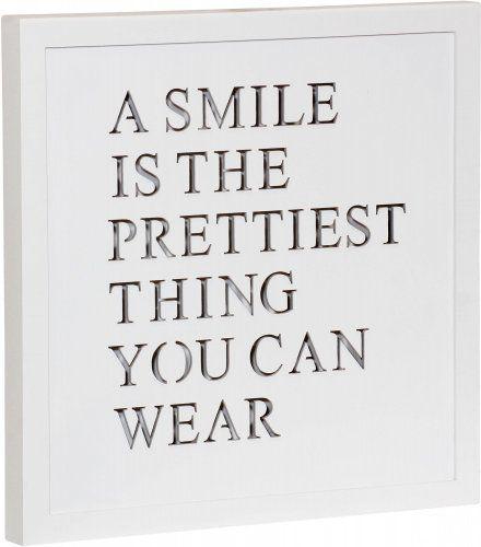 Time Life Dekorační deska Smile s podsvícením. Pokud umístíte tuto dekorační desku do předsíně, vždy když budete odcházet, připomene vám, že to nejlepší, co vám sluší, je váš úsměv. Nikdy tak už nepůjdete z domova zamračení.