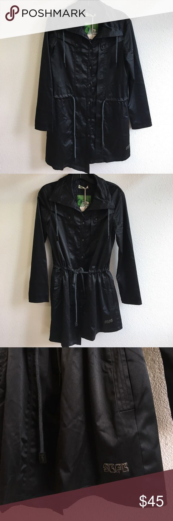 NWT small Skunk Funk black coat NWT size small Skunk Funk black trench coat, mid waist draw string, abstract cut at the bottom 50% polyester 45% cotton 5% elastin Skunk Funk Jackets & Coats Trench Coats