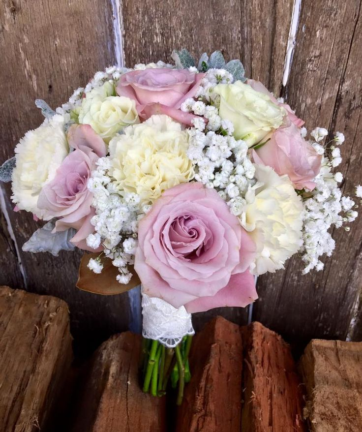 bridesmaid bouquet of vintage pink roses, sims, spray roses and babies breath