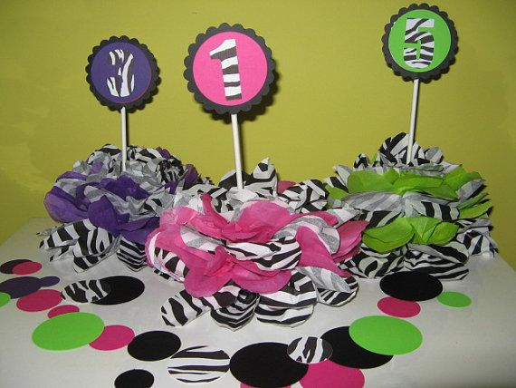Zebra centerpiece table decoration with purple favor by missdaisyw, $8.00 Not zebra but the idea..??Red and black with 72?