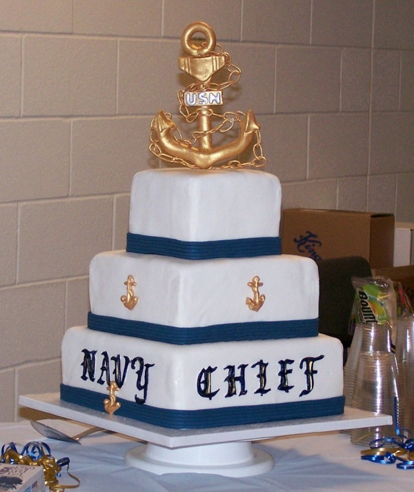 Navy Chief Ret. Cake.  I like the anchor on the top with the white and blue, but would leave the writing and side anchors off or do a little different.