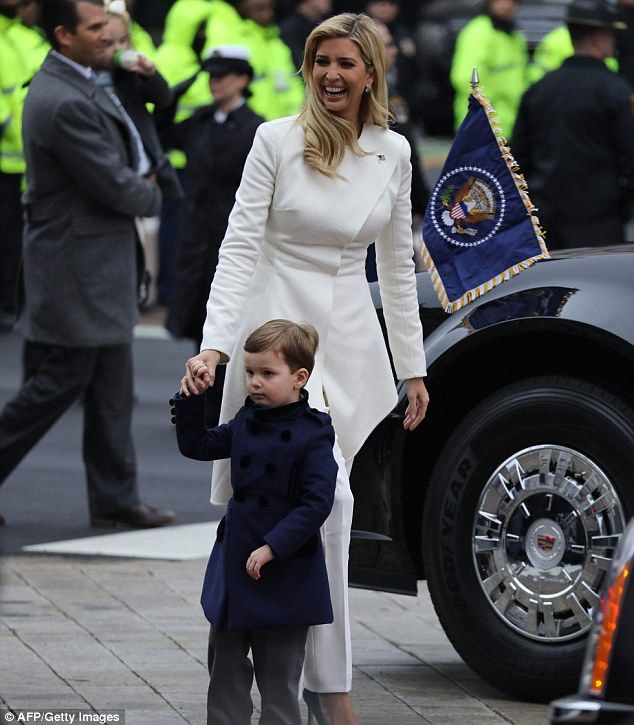 The 35-year-old was all smiles as she walked with her three-year-old son Joseph in the parade