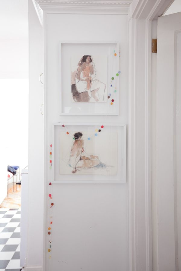 have fun with your artwork displays by adding a quirky little element. via A CUP OF JO: San Francisco apartment tour (500-square-feet!)