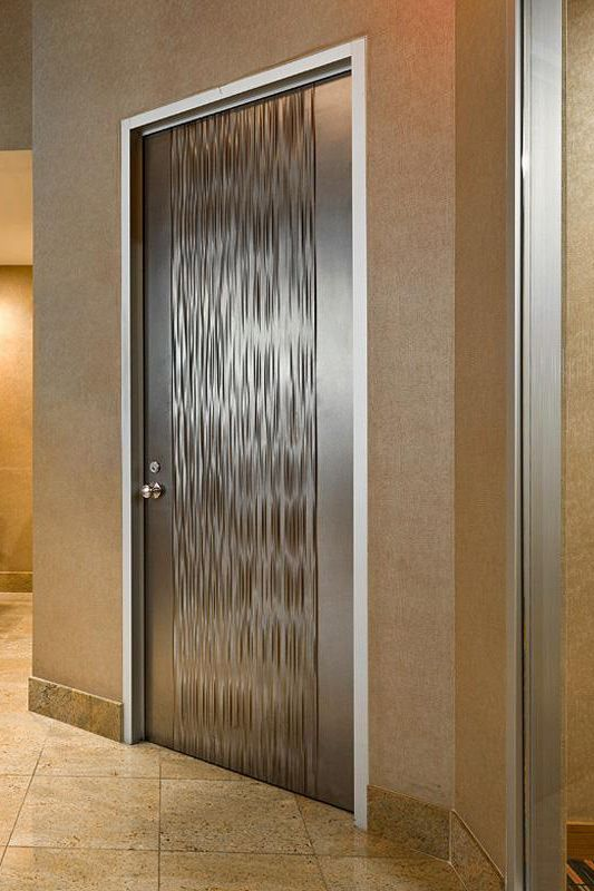Door shown in Fused Nickel Silver with Seastone finish and Kalahari pattern at the New York Helmsley Hotel, New York, New York