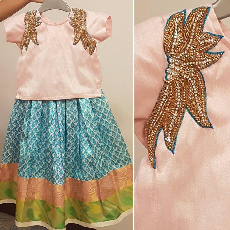 Shoulder zardosi embroidered raw silk blouse paired with traditional kancheevaram Silk Skirt! For Orders and Queries reach us at 044-42179088 WhatsApp: 9789903599 Address: No.21, Valmiki street, Thiruvanmyur #traditionalskirt #pattupavadai #kidswear #yutiforkids #babypinksilkblouse #blueskirt #simpleembroideredblouse #simpleembroidery #blueandpink #yuti #YUTIDesignerHouse #chennaidesigner