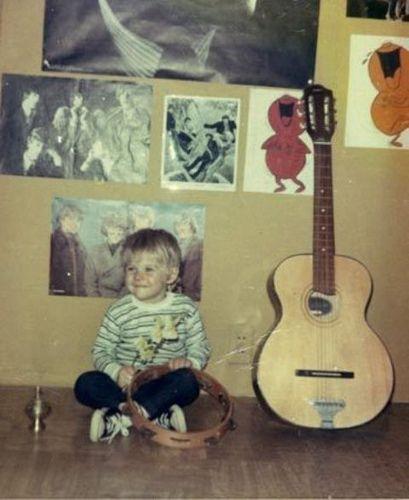 young kurt cobain. I love the drawings on his walls