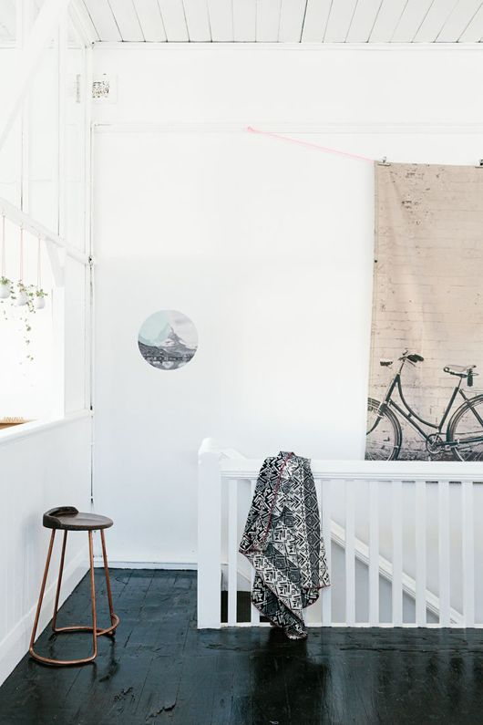 black floor + white walls + circle art