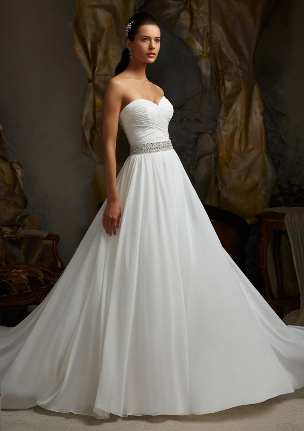 Delicately Flowing Bridal Dress with a Sweetheart Neckline and a Removable Belt. Colors available: White and Ivory, Sizes Available: 2-28.