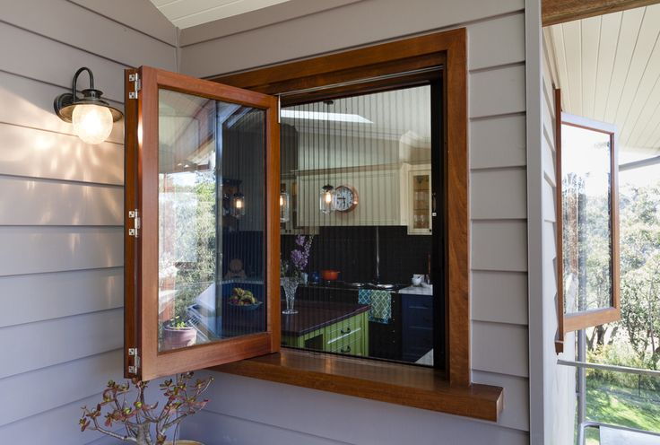 Red Gum bi-fold window by Against the Grain Windows & Doors - fitted with Brio retractable insect screen to keep the bugs out! Genius!