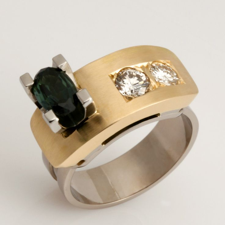 www.robertpaul.com.au  Ladies 18ct yellow and white gold 'Archie' style ring featuring a blue/green sapphire and diamonds