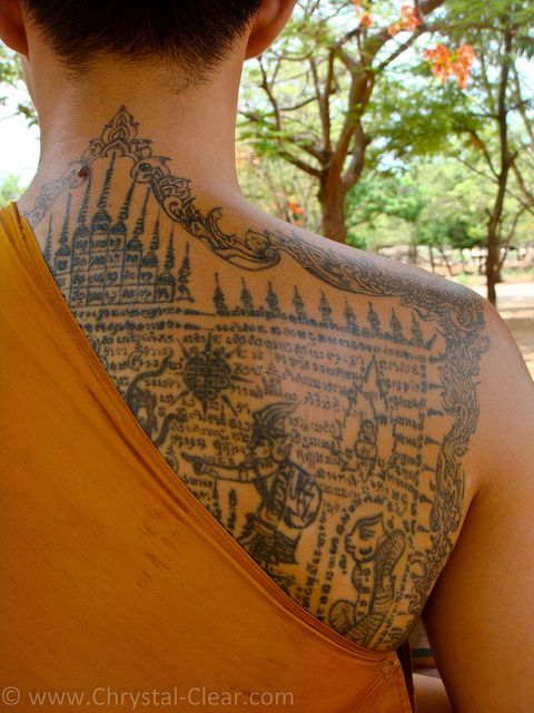 tattoos of Buddhist sutras (texts) and yantras (sacred Buddhist symbols and geometric designs)
