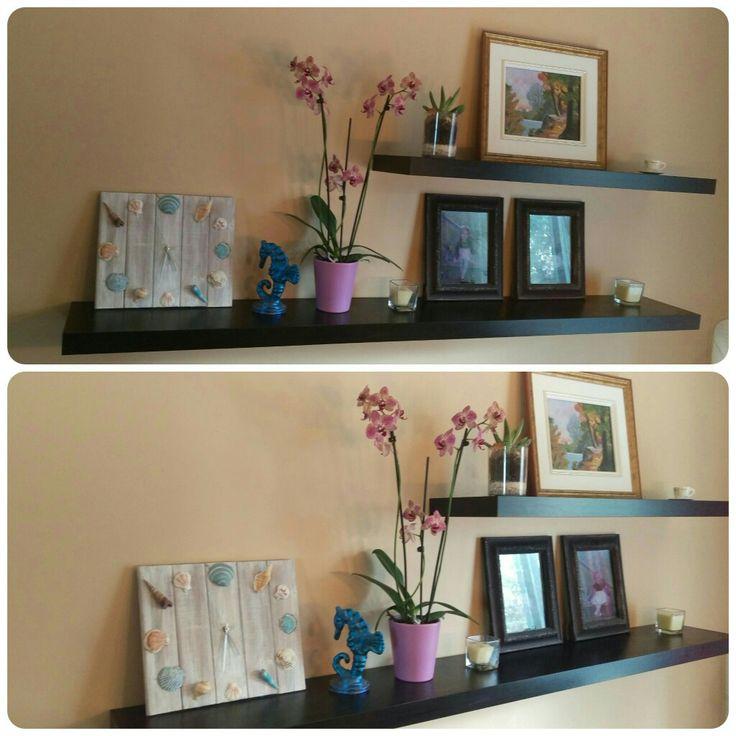 Ma déco presque tout est fait à la main (diy) : l'horloge avec coquillage, ma toute première toile, l'hippocampe en argile, un petit terrarium avec dinosaure et j'ai même repeint la couleur des cadres avec photos. Les fleurs c'est un cadeau! :)
