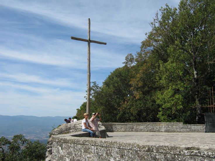 The Franciscan wooden cross at La Verna, in front of a stunning view of Casentino valley