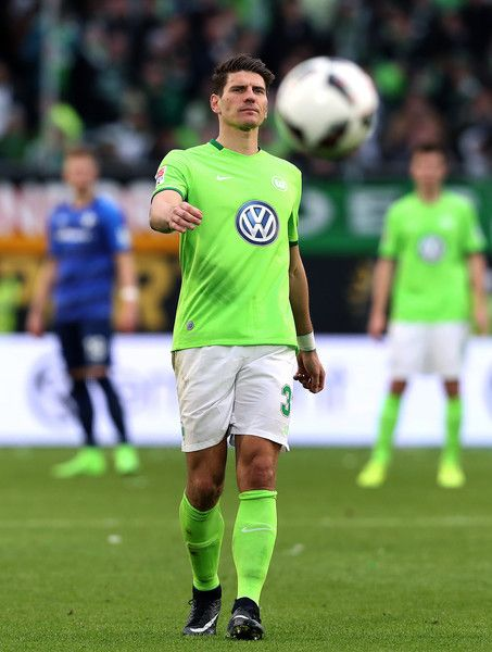 Mario Gomez of Wolfsburg kicks the ball during the Bundesliga match between VfL Wolfsburg and SV Darmstadt 98 at Volkswagen Arena on March 18, 2017 in Wolfsburg, Germany.