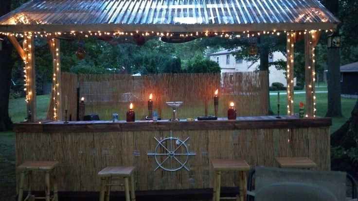 Homemade tiki bar made from pallets kath pinterest for Building a tiki bar from pallets