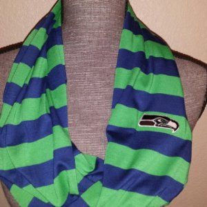 Hey @Alyson  can you need to make us one of these!  :)  Seahawks infinity scarf