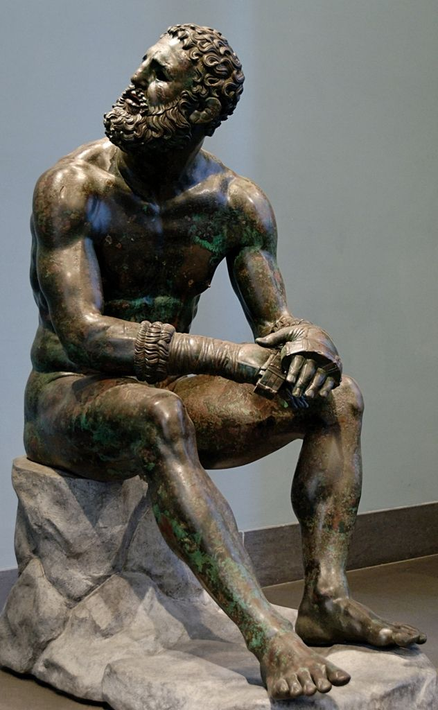 """So-called """"Thermae boxer"""": athlete resting after a boxing match. Bronze, Greek artwork of the Hellenistic era, 3rd-2nd centuries BC (the boulder is modern and replicates the ancient one). From the Thermae of Constantine."""