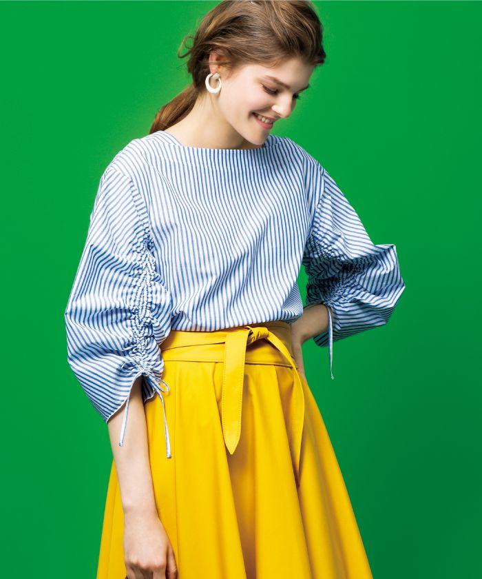 Stripes blouse, yellow skirt.