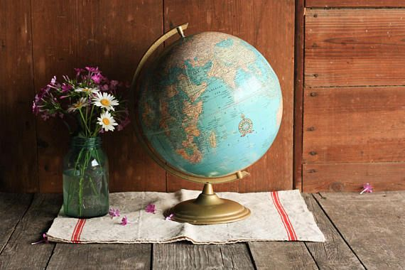 This vintage world globe is a classic piece that will add a touch of travel charm to your home or Rustic wedding decor. It can be used as a wedding globe guest book or a Loft style touch to your bookshelf.