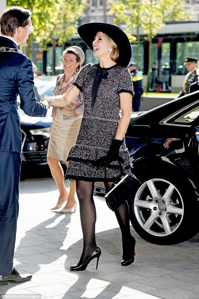 The vivacious Queen showed off a coordinated outfit from head to toe on the sunny day in R...