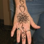this henna flower but real tattoo and on hip?