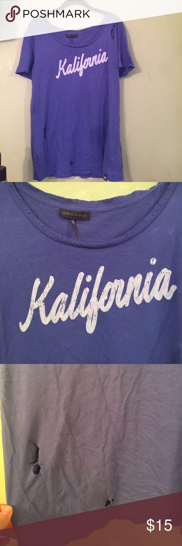 Kendall and Kylie Kalifornia Distressed Tee I wear a size S-M and i wear this for an oversized/ off the shoulder look.. very cute and trendy too with holes for distressed look Kendall & Kylie Tops Tees - Short Sleeve