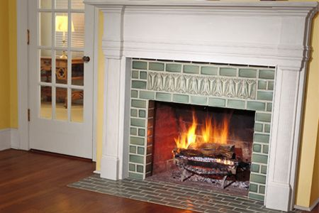 FANTASTIC tutorial on how to tile around your fireplace. I'd like to do this, then build wood past the new tile and create a moulding mantle. Dare to dream...