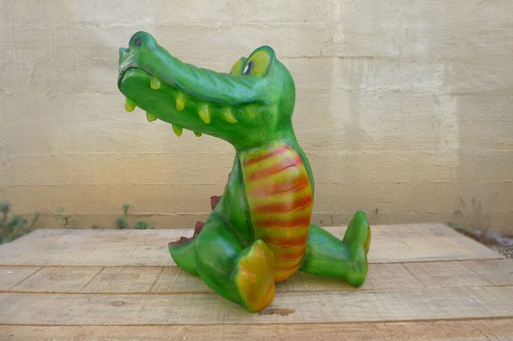 Lamp in the shape of a baby crocodile, made out of fiberglass. It can be put on the floor or on any surface, even on carpeted or wooden floor.  Fiberglass material is robust and unbreakable, as well as very lightweight.  Croco is ideal for any room , especially the children's room. It can be used as a stylish night-light, or just decorate and brighten the space at any time. Children can play with the lamp and it will not cave in!  Dimensions: 38 x 35 x 37cm