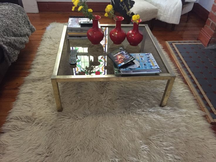 PHOTO FOUR: This is an image of a shag rug used in an interior. This shag rug is synthetic which means keep the rug clean unlike natural fibers is easier. This rug helps complete a shabby chic interior