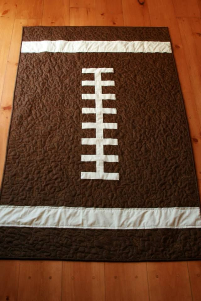 One of my husband's friends is expecting and made this cute baby quilt for a vintage football theme room. Too cute!