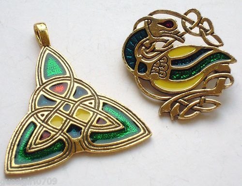 This auction is for a two stunning goldtone & enamel pieces of Celtic jewellery by Miracle Sol D'or.    The Celtic Book of Kells bird brooch measures approx 34mm x 30mm......the triangular Celtic knot pendant measures approx 40mm x 35mm (excluding the integral bail).    Both pieces are stylishly inlaid with blue, green, red & yellow enamel.    Miracle can be seen on the reverse of the bird brooch.....Sol D'or Miracle on the reverse of the pendant.