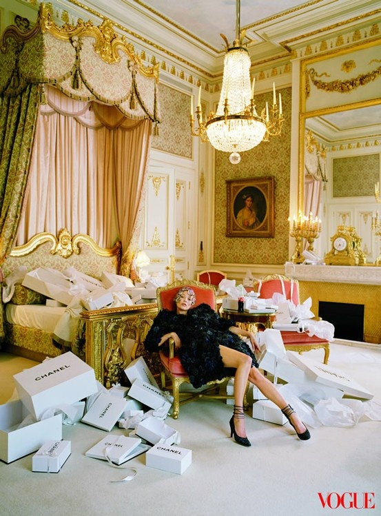 I am just in love with this photo. It serves as a little fantasy escapism for me. While I'm burnt from a long day of open houses, church and walking miles in my high heeled sneakers (yes I said high-heeled sneakers)..Kate Moss looks as if she's burnt from a day of luxurious shopping, doesn't she? I want to come back to this room! I'm loving all the baroque detailing, Victorian gold molding, chandelier, and boudoir feel. And gees, can you imagine coming home with this much Chanel?!…