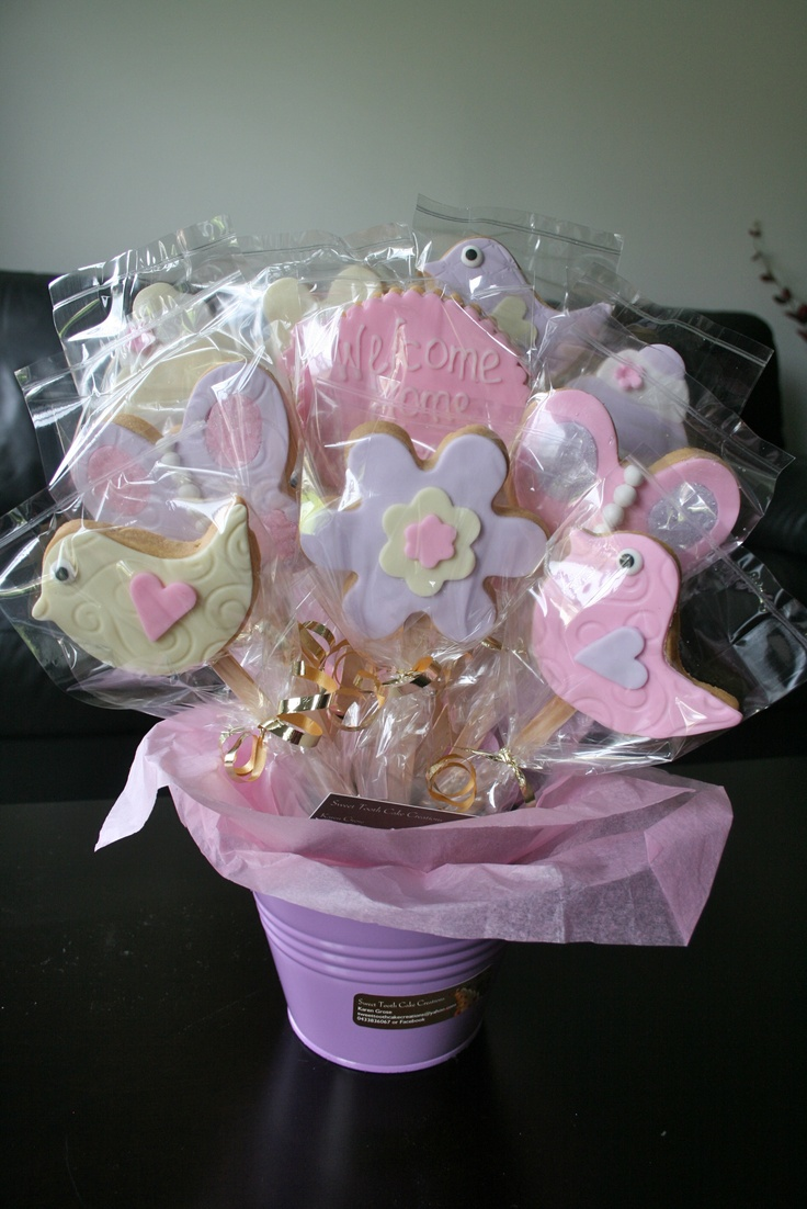 Biscuit/cookie  bouquets :)  Delicious !!    Made by me :) Sweet Tooth Cake Creations.  Great gift idea for new baby, baby shower, get well, mothers day, birthday, thankyou...the list goes on