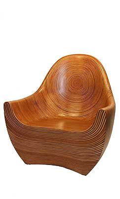 Showtime Regal Chair: Inlaid with rattan strips. Would go nowhere in my house but it is a seriously good looking chair